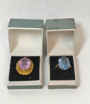 Blue spinel ring in 9ct gold and another amethyst, probably 9ct gold. (2).
