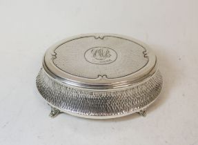 Silver oval bijouterie box, hammered, monogramed and dated 1909, by Zimmermans, Birmingham 1908.