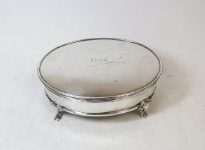 Silver oval bijouterie box, initialled, on spreading feet, Sheffield 1928, 16cm.