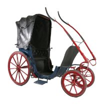 PONY PHAETON, or invalid carriage. In blue on maroon/red running gear, lined black. Leather head and