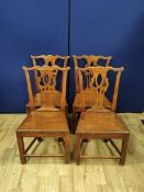 Set of four Georgian oak country chairs with pierced fiddle back, solid seat. 94cm high. (4).