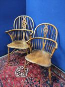 Pair of near matching ash and elm Windsor armchairs, both with spindle hoop back, with pierced splat