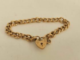 9ct gold curb bracelet with padlock. 23g.