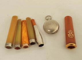 Silver sovereign purse, Birmingham 1905, a French amber cheroot holder with gold mounts and