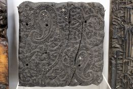 Five various 19th century wooden textile printing blocks: one of square form with paisley pattern