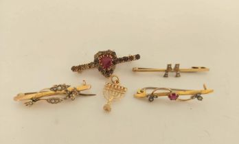 Four gold and other bar brooches and a charm.