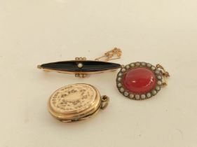 Georgian carnelian and pearl brooch, a mourning brooch and a locket. (3).