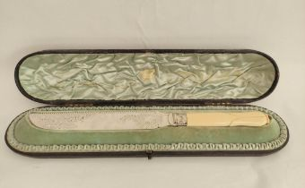 Good e.p. cake knife, engraved with carved ivory handle, the silver ferrule Sheffield 1897, cased.