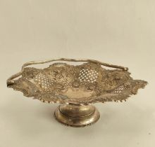Silver octofoil cake basket, pierced and embossed with flowers, fruit and scrolls, by G. Hutton,