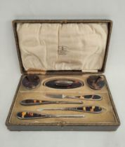 Silver mounted tortoiseshell manicure set in fitted case, Chester 1922, for Grant Castle.