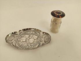 Silver mounted smelling salts bottle, Birmingham 1920, and an embossed pin tray of lobed oval