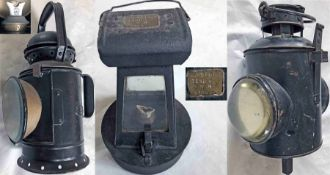 Trio of Great Western Railway LAMPS comprising a 3-aspect handlamp, stamped GWR, with reservoir