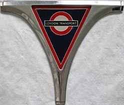 London Transport Routemaster RADIATOR BADGE complete with original grille surround piece. It is