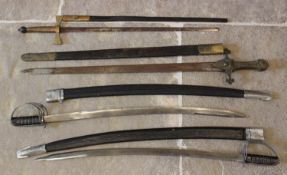 A military sword, probably 19th century, the 74cm unfullered double edged blade set to a cruciform