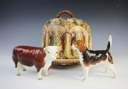 A majolica cheese bell and stand, 19th century, the brown mottled bell with a continuous relief