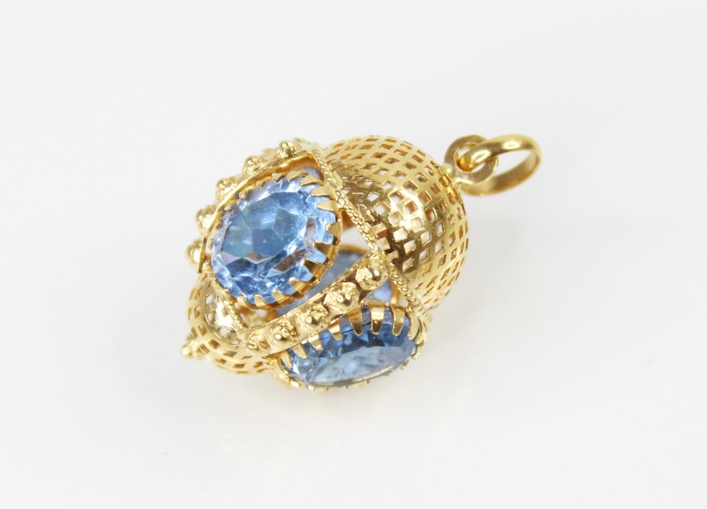 A Victorian style 18ct gold paste set fob charm, comprising four oval mixed cut blue paste, (each