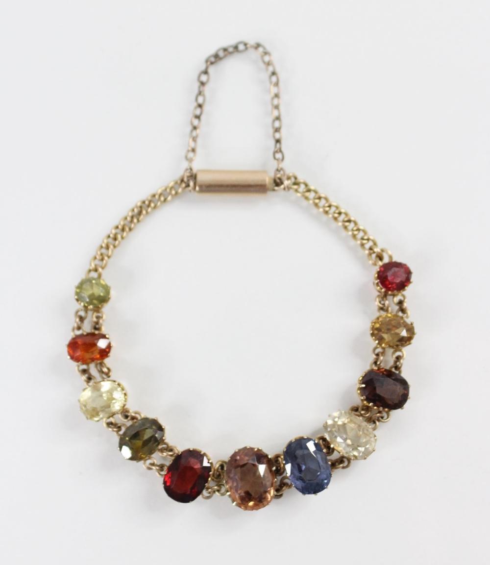An Edwardian multi gem set fringe necklace, comprising sixteen graduated oval gemstones, including - Image 4 of 6