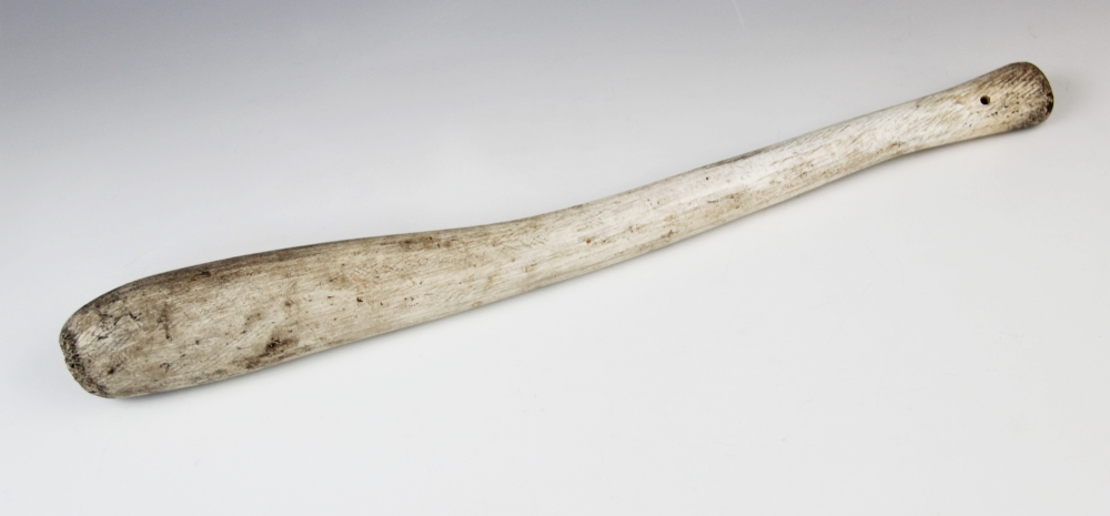 An Inuit Oosik club, walrus baculum (penis bone), 19th century, 48.5cm long overall Provenance: