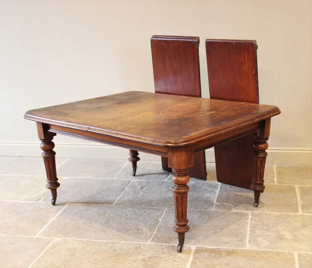 A Victorian mahogany extending dining table, the rectangular moulded top with rounded corners, - Image 2 of 2
