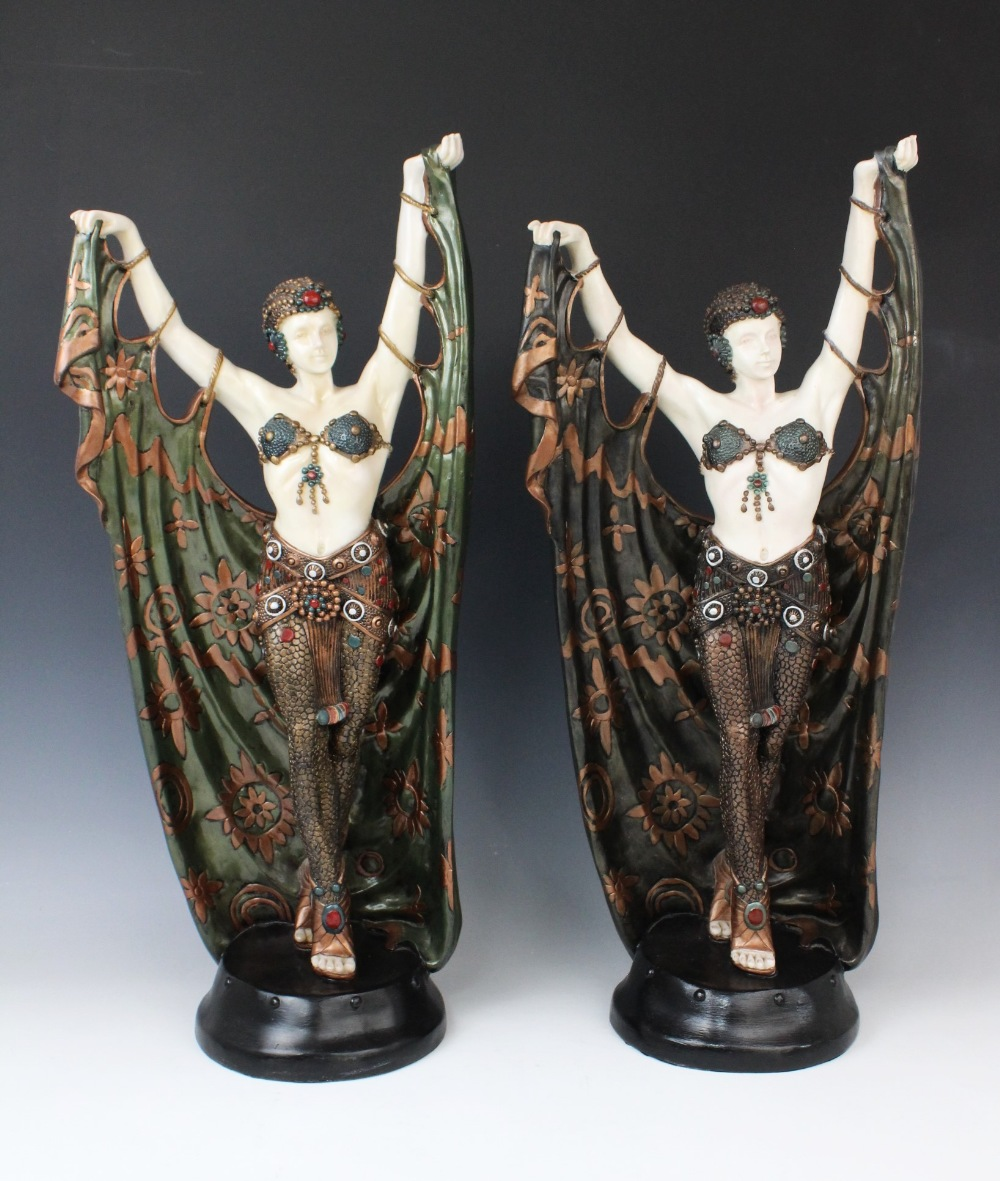 A pair of composite Art Deco style faux chryselephantine figures, late 20th century, modelled in the