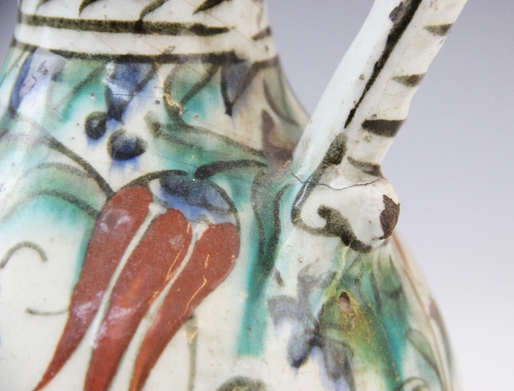 An Ottoman Empire Turkish polychrome pottery jug, of pear shape with attached handle and flared - Image 4 of 9