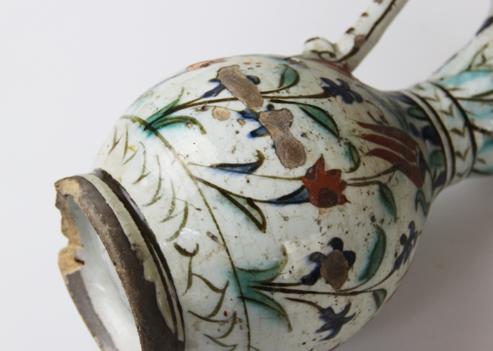 An Ottoman Empire Turkish polychrome pottery jug, of pear shape with attached handle and flared - Image 8 of 9