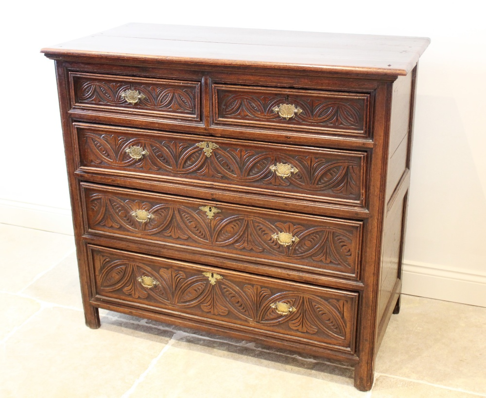 A 17th century and later oak chest of drawers, the twin plank top over an arrangement of two short