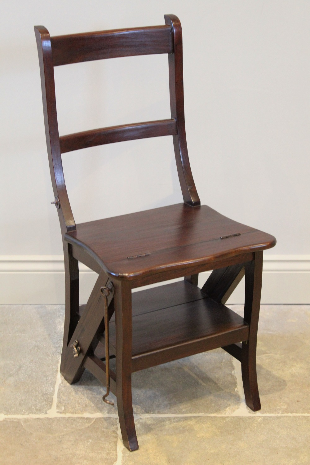 A set of mahogany metamorphic library steps, late 20th century, the chair with a twin rail back