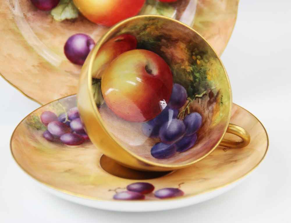 A Royal Worcester porcelain trio, mid 20th century, comprising a teacup, the interior hand painted - Image 3 of 9