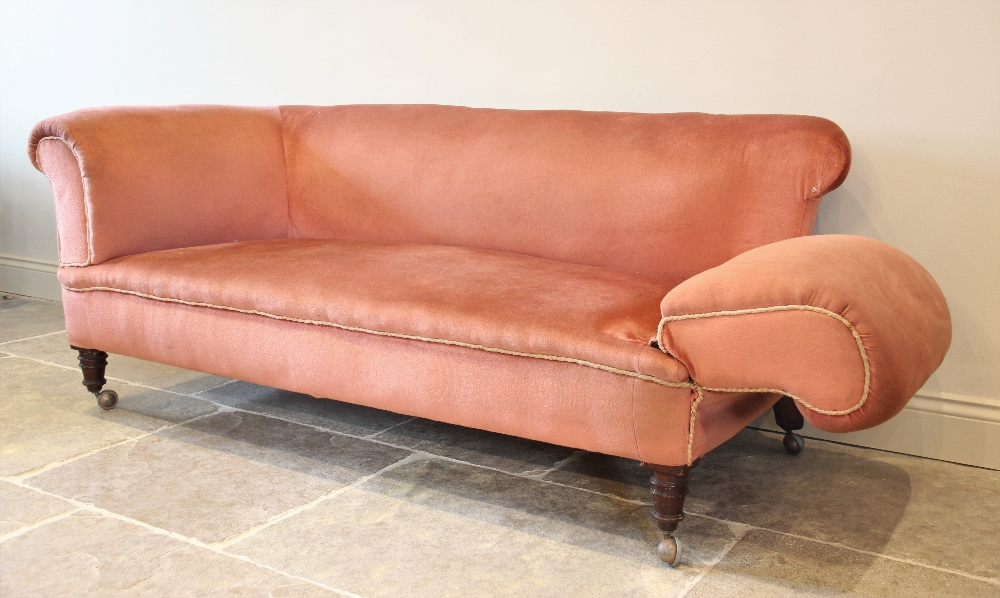 A late Victorian Chesterfield type drop end settee, upholstered in pink velour with applied