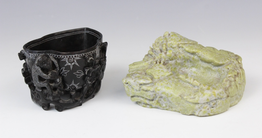 Two Chinese soapstone brush washer, 20th century, comprising; a black soapstone example carved