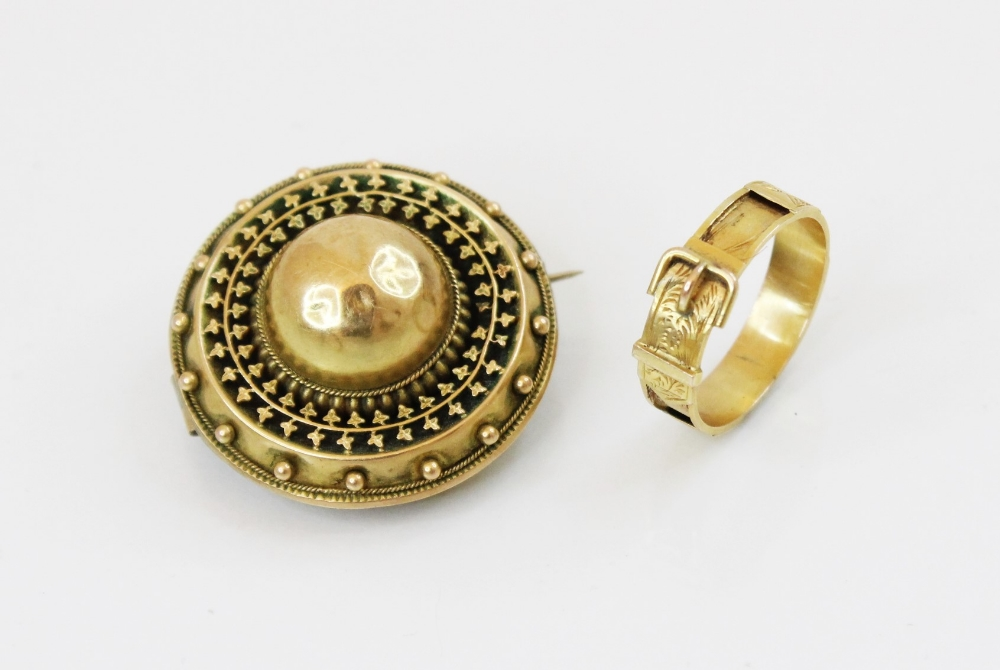 A 19th century yellow metal memorial buckle ring, with engraved decoration, vacant hair panel shank,