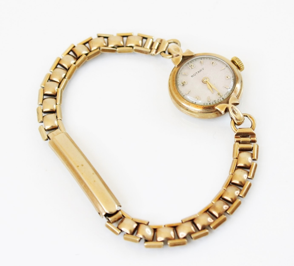 A lady's vintage 9ct gold Rotary wristwatch, the round cream dial with Arabic and baton markers, set