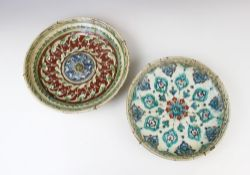 A collection of 17th century Ottoman Empire Turkish polychrome pottery wares, comprising; a charger,