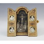 A silver gilt and Niello travelling triptych, 19th century, the central arched panel depicting the