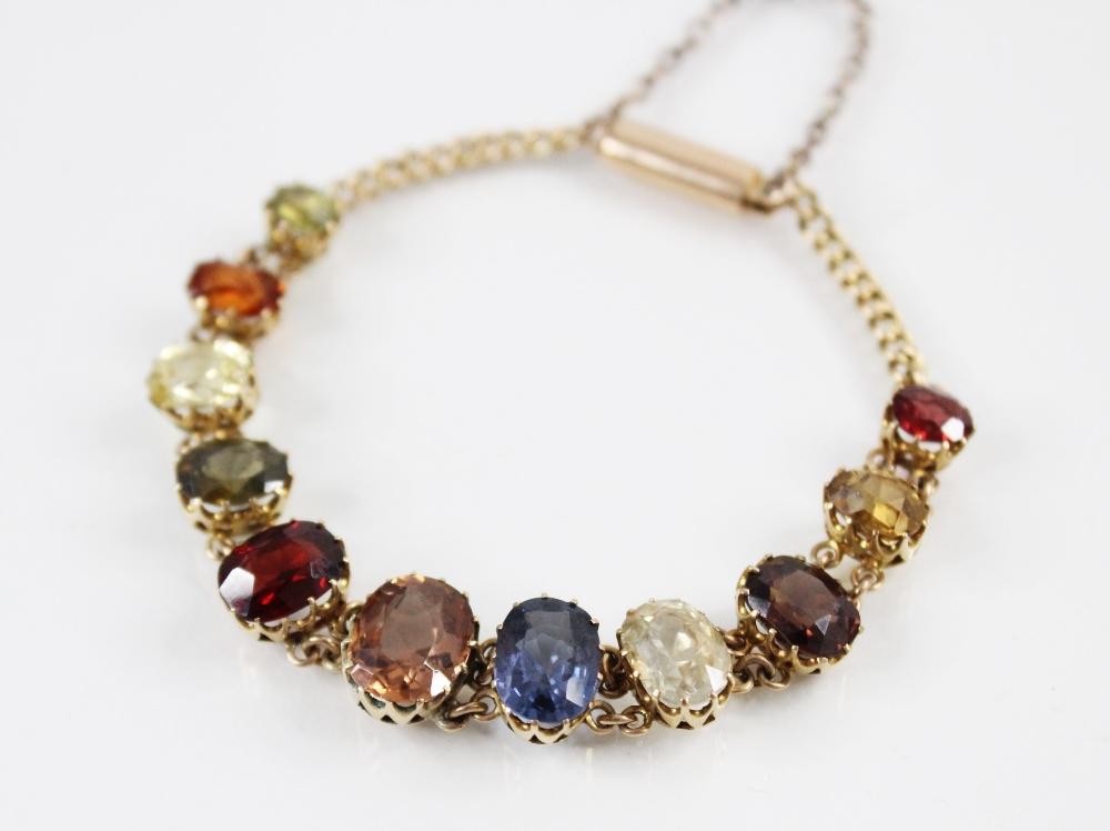An Edwardian multi gem set fringe necklace, comprising sixteen graduated oval gemstones, including - Image 5 of 6