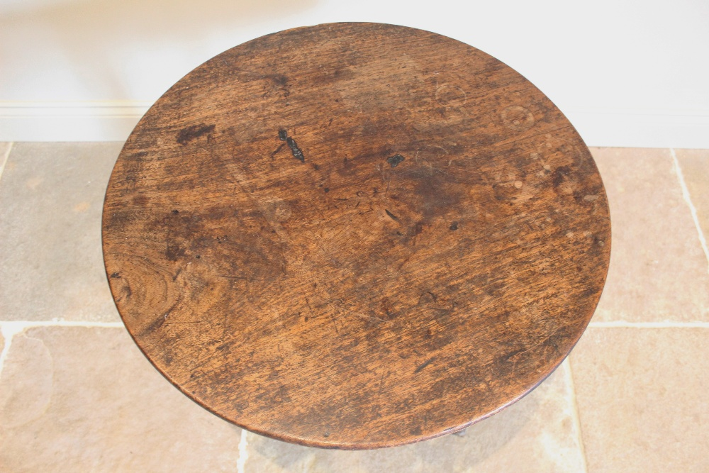 A George III oak tripod table, the circular top raised upon a baluster column extending to three - Image 2 of 2