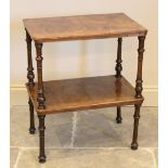 A Victorian burr walnut two tier occasional table, the rectangular tiers raised raised upon turned