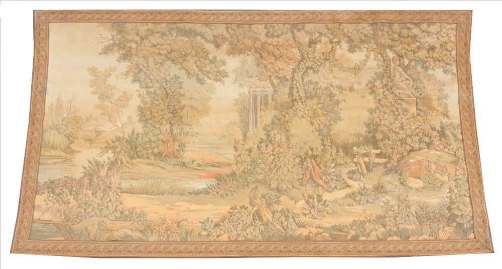 An early 20th century French machine woven tapestry, depicting architectural columns in a tree lined