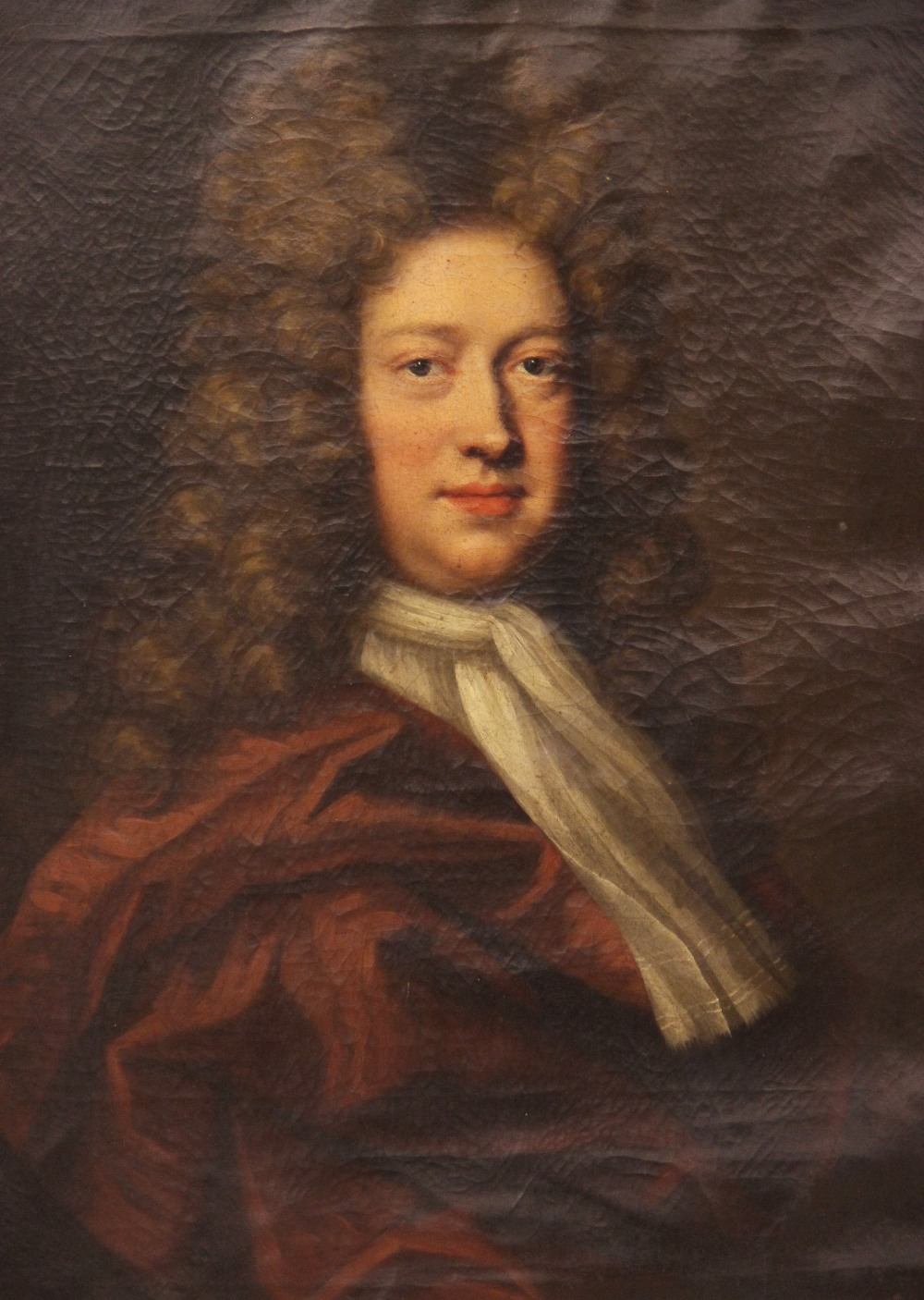 Circle of Michael Dahl (1659-1743), Portrait of George Kenyon half length wearing a red cloak and - Image 2 of 6