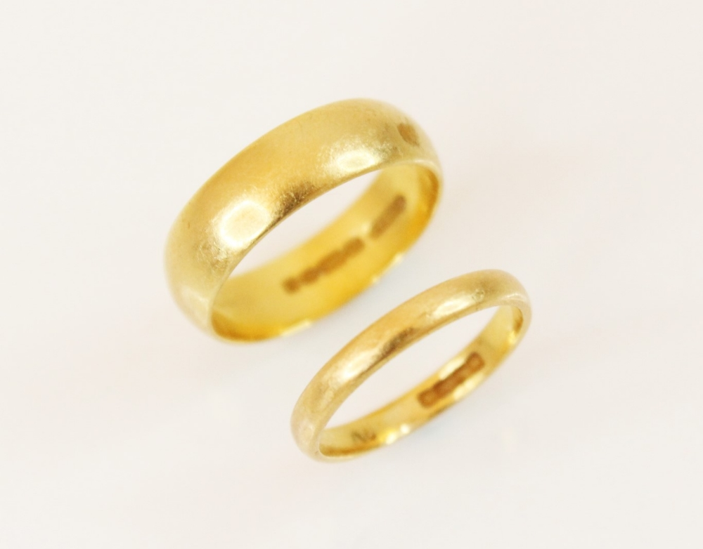A 22ct gold wedding band, marks for Birmingham 1978, ring size K, together with a further example
