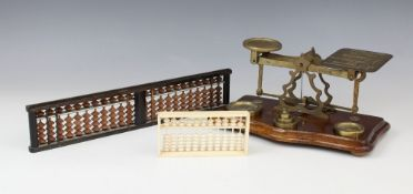 A set of brass postal scales, 20th century, the balance bar stamped 'Warranted Accurate', the