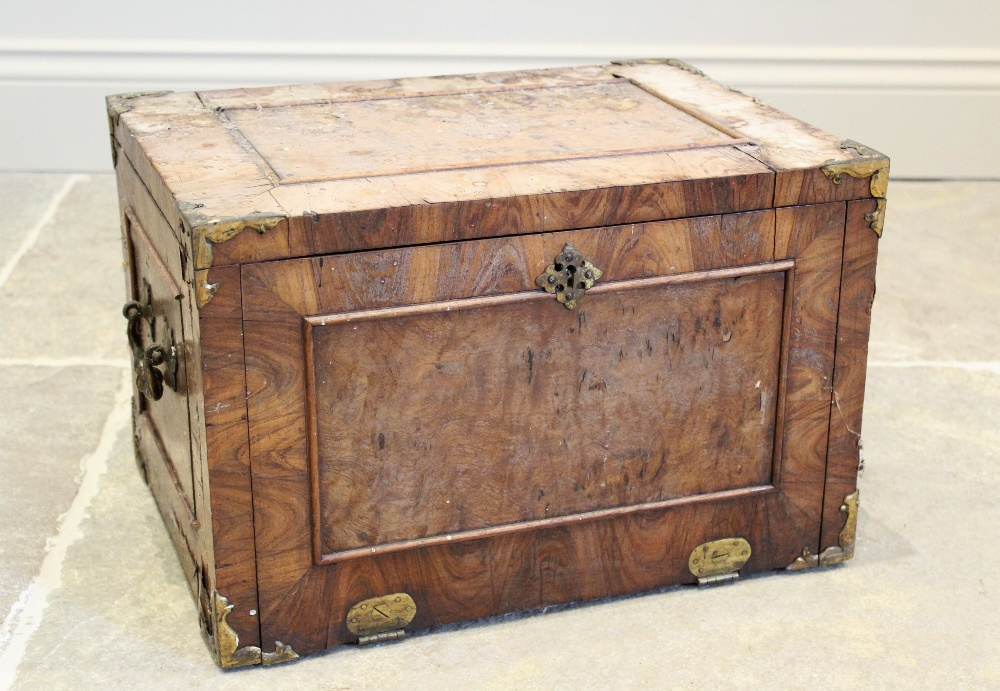 A late 17th century French kingwood strong box, applied with gilt metal corner mounts and side swing
