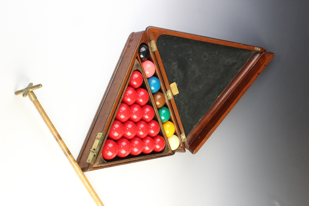 An Edwardian mahogany snooker compendium, of triangular form, opening to reveal original triangle