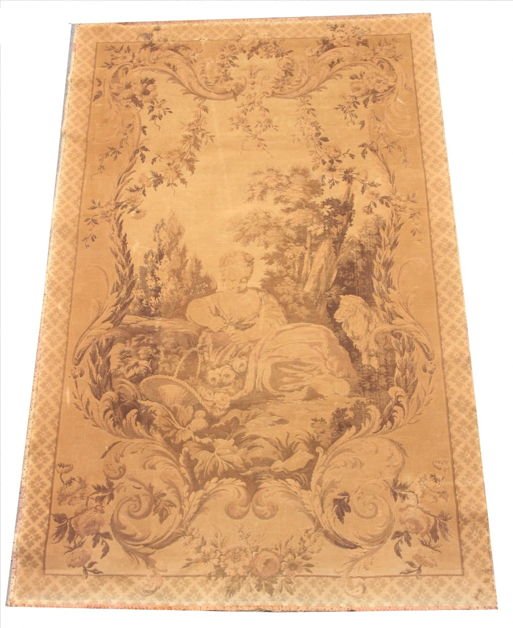 An early 20th century French machine woven tapestry, depicting architectural columns in a tree lined - Image 2 of 2