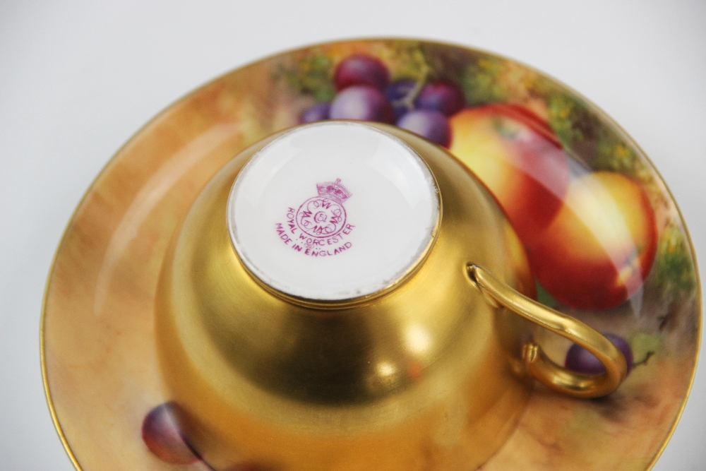 A Royal Worcester porcelain trio, mid 20th century, comprising a teacup, the interior hand painted - Image 5 of 9