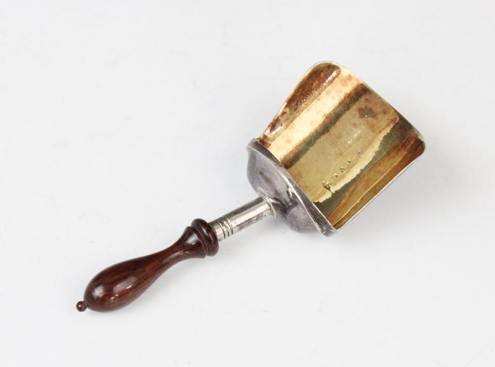 A George III silver caddy spoon by Samuel Pemberton, Birmingham (date letter worn) with turned