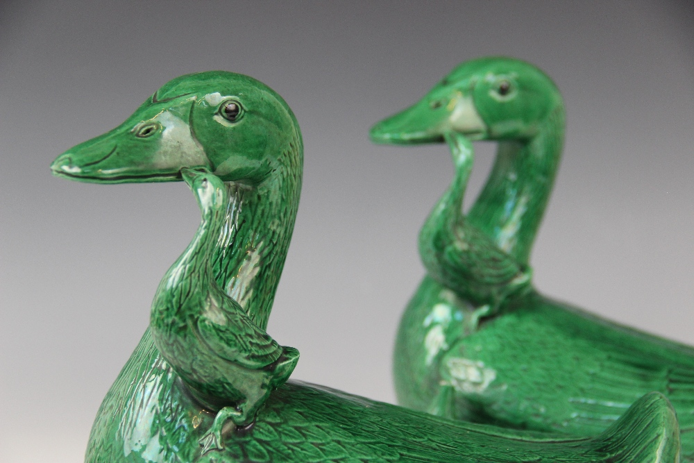 A pair of Chinese porcelain green glazed ducks, early 20th century, each modelled with two - Image 3 of 4