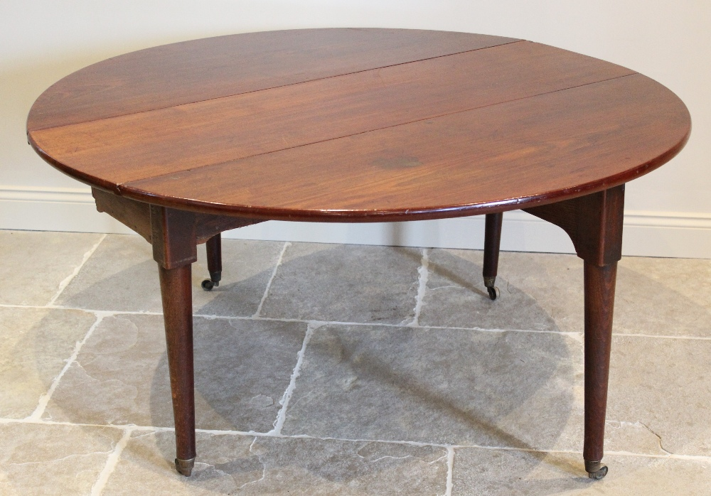 A George III oval drop leaf table, the mahogany top raised upon associated oak legs of tapering - Image 2 of 2