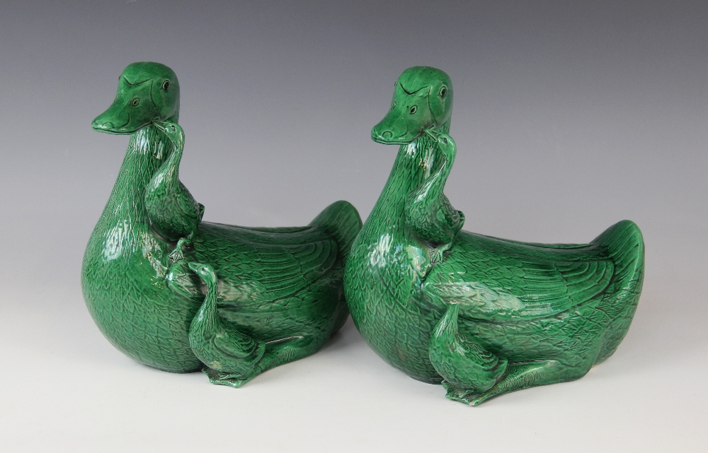 A pair of Chinese porcelain green glazed ducks, early 20th century, each modelled with two